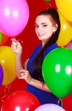 Portrait of a young attractive woman among many bright balloons Royalty Free Stock Photography