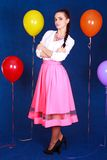 Portrait of a young attractive woman near many bright balloons Royalty Free Stock Photography