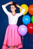 Portrait of a young attractive woman near many bright balloons Royalty Free Stock Photos
