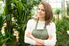 Portrait of a young attractive woman at the plants nursery Stock Photo