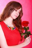 Portrait of a young attractive woman with a red rose Royalty Free Stock Photos