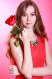 Portrait of a young attractive woman with a red rose Stock Photography