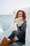 Portrait of young attractive woman with scarf on winter beach Royalty Free Stock Photo
