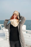 Portrait of young attractive woman with scarf on winter beach Royalty Free Stock Photos