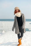 Portrait of young attractive woman with scarf on winter beach Stock Photo