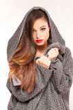 Portrait of a young attractive woman trying to keep warm. Stock Image