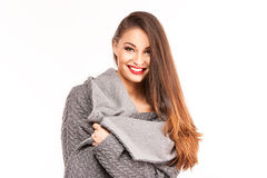 Portrait of a young attractive woman trying to keep warm. Royalty Free Stock Photography