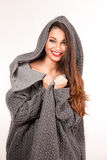 Portrait of a young attractive woman trying to keep warm. Royalty Free Stock Photo