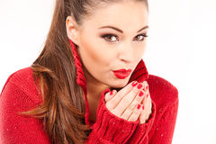 Portrait of a young attractive woman trying to keep warm. Royalty Free Stock Images