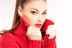 Portrait of a young attractive woman trying to keep warm. Stock Images
