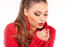 Portrait of a young attractive woman trying to keep warm. Stock Photography
