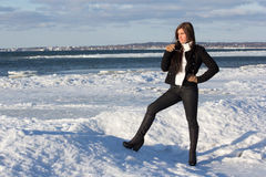 Portrait of young woman on winter beach Stock Photo