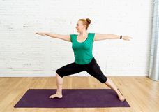 Strong woman training yoga in at modern studio home in healthy lifestyle concept royalty free stock images