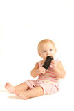 Portrait of young baby playing with comb Royalty Free Stock Image