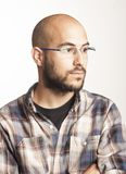 Portrait of a young bald man with a beard and glasses Stock Photography