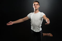 Portrait Of Young Ballet Dancer On Black Background. Handsome Male Ballet Dancer On A Black Background Royalty Free Stock Image