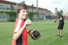 Portrait of a young baseball player in a field Stock Photo