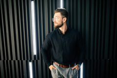 Portrait of Young bearded businessman standing in office lobby Royalty Free Stock Photography
