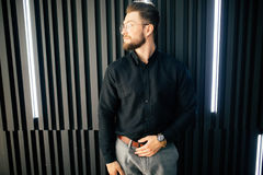 Portrait of Young bearded businessman standing in office lobby Stock Image