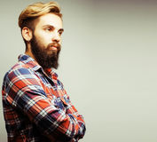 Portrait of young bearded hipster guy smiling on white backgroun Stock Image