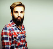 Portrait of young bearded hipster guy smiling on white backgroun Stock Photo