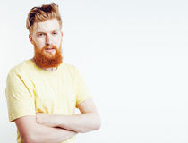 Portrait of young bearded hipster guy smiling on white backgroun Royalty Free Stock Images