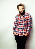 Portrait of young bearded hipster guy smiling on white background close up, brutal man, lifestyle people concept Royalty Free Stock Images