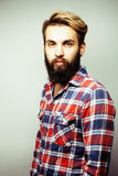 Portrait of young bearded hipster guy smiling on white background close up, brutal man, lifestyle people concept Stock Images
