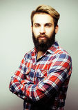 Portrait of young bearded hipster guy smiling on white background close up, brutal man, lifestyle people concept Royalty Free Stock Image