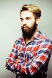 Portrait of young bearded hipster guy smiling on white background close up, brutal man, lifestyle people concept Royalty Free Stock Photos