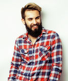 Portrait of young bearded hipster guy smiling on white background close up, brutal modern man Stock Photos