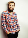 Portrait of young bearded hipster guy smiling on Stock Images