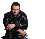Portrait of a young bearded man in a leather jacket. On a white background Stock Photos
