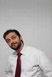 Portrait of a young bearded man. With red tie Stock Image