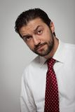 Portrait of a young bearded man. With red tie Stock Photography
