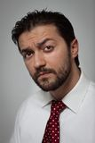 Portrait of a young bearded man. With red tie Stock Images