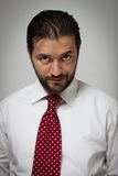 Portrait of a young bearded man. With red tie Royalty Free Stock Photos