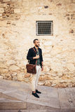 Portrait of young bearded man standing  on the street Royalty Free Stock Photos
