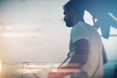 Portrait of young bearded man standing on a yacht Stock Photos