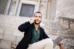 Portrait of young bearded man talking on his phone Royalty Free Stock Image