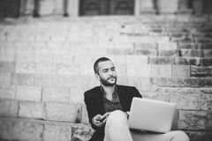 Portrait of young bearded man using his laptop Stock Images