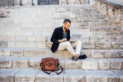 Portrait of young bearded man using his laptop Royalty Free Stock Photo
