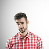 Portrait of young bearded man winking with his left eye Stock Photos