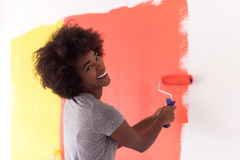 Black woman painting wall Royalty Free Stock Images