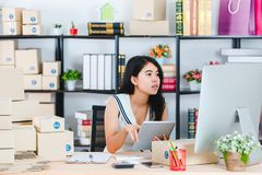 Young Asian business lady at office stock photography