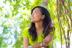 Portrait of young beautiful asian girl looking up Royalty Free Stock Images