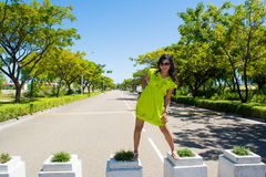 Portrait of young beautiful asian girl rising standing at street Royalty Free Stock Photography