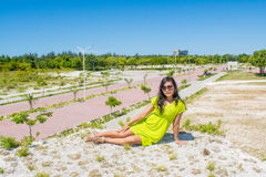 Portrait of young beautiful asian girl  sitting at the top of the hill looking front Royalty Free Stock Images