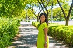 Portrait of young beautiful asian girl standing on the road looking at camera Stock Photos