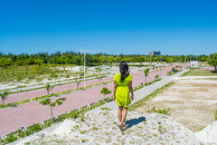 Portrait of young beautiful asian girl  standing at at the top of the hill Royalty Free Stock Photos